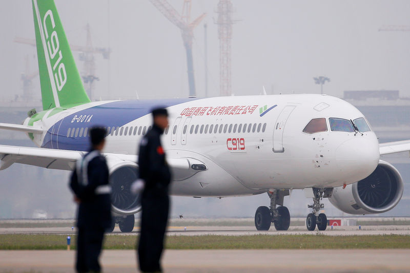 Typhoon winds hit Shanghai, disrupting flights and shipping