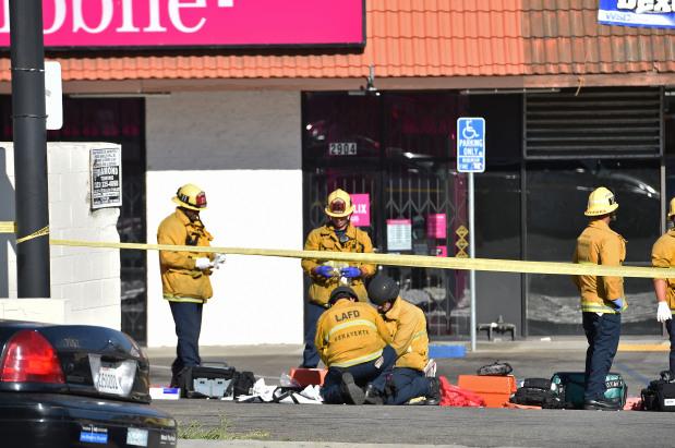 One dead, suspect surrenders after US supermarket hostage drama