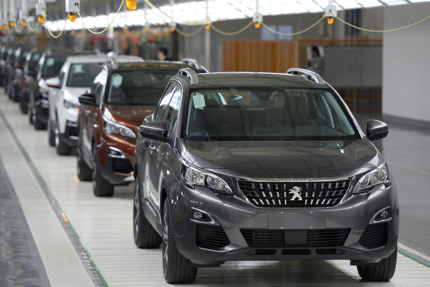 Peugeot surges as Opel hits road to recovery
