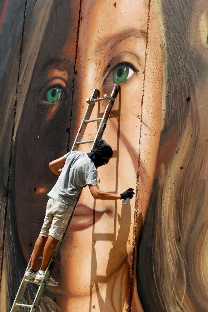 Israel arrests Italians who painted mural of Ahed Tamimi