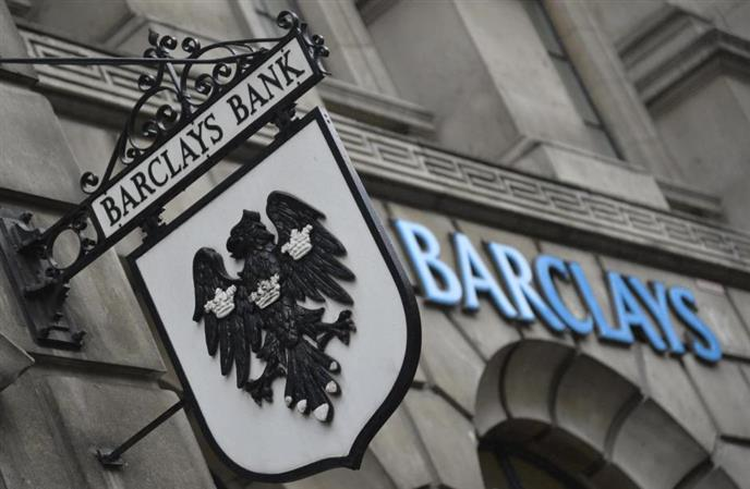 UK bank Barclays back in black in first half