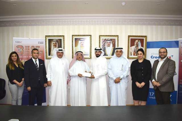 <p><em>Al Hawaj managing director Jawad Al Hawaj, fourth from left, presents a winner with his prize, in the presence of general manager Abdulwahab Al Hawaj, third from right, CrediMax merchant services and sales manager Khalid </em>Showaiter<em>, third from left, and CrediMax representatives.</em></p>