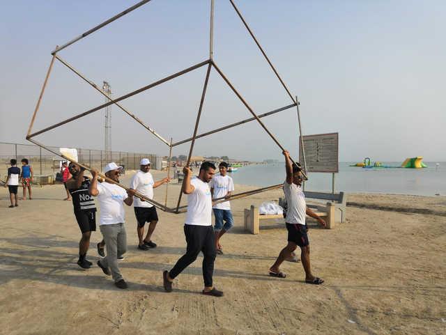 Residents of Malkiya set up a beach chalet