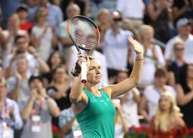 Halep tames Barty to enter final