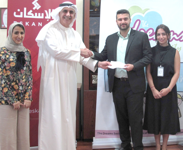 Proceeds from a charity event hosted by Eskan Bank were donated to the Dreams Society, a non-profit organisation that grants wishes to terminally and seriously ill children. Charity Dish was held in April and raised BD2,000 and featured stands from different departments from the bank selling sweets and traditional cuisines. Above, bank general manager Dr Khalid Abdulla, second from left, presenting the donation to society board member Hussain Al Qaseer during a ceremony at the bank's headquarters in Seef District.