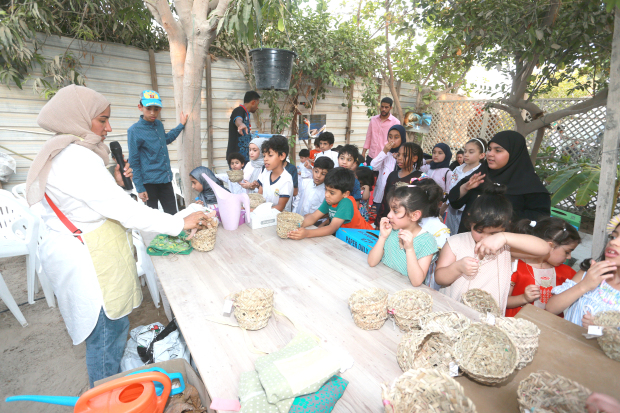 """Around 50 children took part in a Hiya Biya event. The celebration features children releasing baskets of plants and flowerpots into the sea and is based around the concept of sacrifice. A special event, """"Ein Al Hayah"""", was held at a farm in Nabih Saleh organised by Nabih Saleh Club, Nabih Saleh Charity Society and Bahrain Women Association for Human Development. All natural materials were used to make the Hiya Biya as part of the Eco Village to raise environmental awareness among children. Above, some of the children taking part in the activity."""
