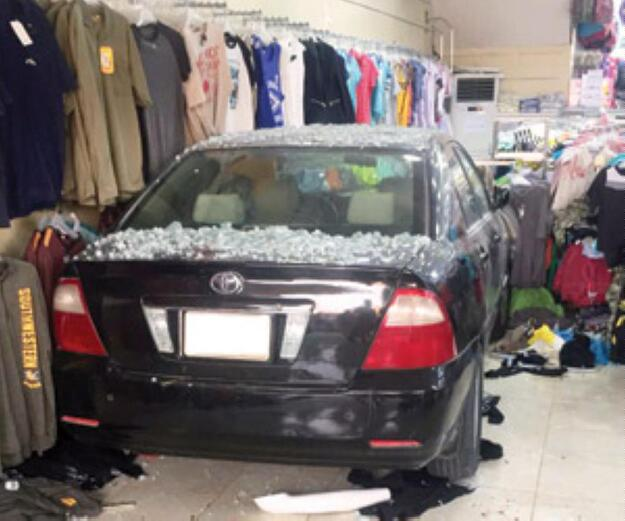 Car driven by woman crashes into shop