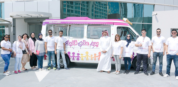 """More than 3,000 ice creams were distributed to the local community as part of """"Beat the Heat"""" campaign by VIVA Bahrain. Two VIVA trucks travelled across Bahrain to hand out the icy treats at different locations, including construction sites and neighbourhoods in Sitra, Riffa, Manama, Hamad Town, Salmabad and Muharraq. Above, the VIVA Bahrain team during the campaign."""