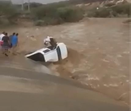 WATCH: Man rescued from drowning after his car is swept away