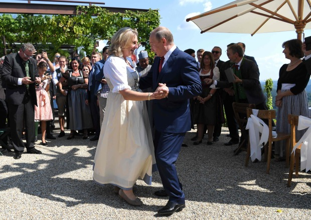 PICTURES: Cossacks and flowers as Putin dances at Austrian minister's wedding