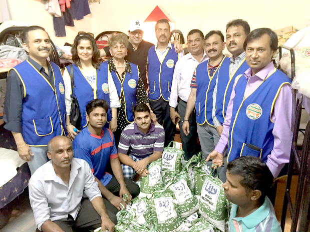 <p><em>ICRF members with the labourers.</em></p> <p>Sixty workers at a labour camp in Khamis were presented with a five-kilo bag of rice each by the Indian Community Relief Fund (ICRF).</p> <p><em><br /></em></p>