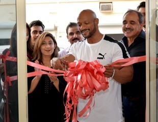 <p><em>Mr Al Haddad cuts the ribbon to inaugurate the centre in the presence of Mr Barlas, right, Ms Barlas, left, and other guests</em></p> <p>The third branch of Afro Rent A Car was inaugurated in Hoora.Chiefguest was International Federation of Bodybuilding and Fitness champion Bahraini Sami Al Haddad.</p> <div>Also present were company chief executive Mujtaba Afroz Barlas, administrative manager Rija Barlas and guests</div>