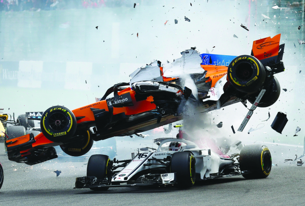 Brave Vettel wins on day of carnage
