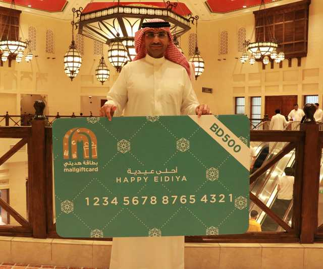 <p>Ten shoppers won gift cards worth BD500 each as part of City Centre Bahrain's Eid Al Adha celebrations. Sarah Al Muharraqi, Fatima Habib, Treif Al Doseri, Muthanna Tuqan, Ahmed Al Haffar, Mekinda Rivero, Mohammed Saad, Daiserie Mariano, Zaytoon Al Mahari and Neeloth Mohammedali won in the 'Happy Eidiya' competition which was open to shoppers who spent at least BD30 at the mall, for a chance to win daily. Above,MrSaad holding up his prize. Top,MrTuqan, left, with his gift card.</p><p><br></p><p><br></p><p>Pictured:Mr Saad holding up his prize</p>