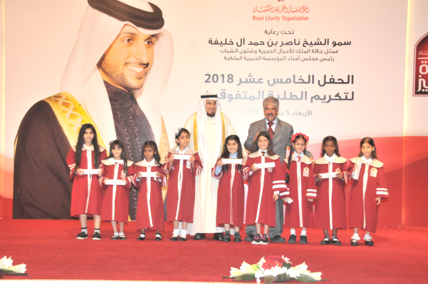 <p>A ceremony to honour 535 orphans who achieved outstanding results in the previous academic year was held yesterday at Bahrain University's Sakhir campus. The event, in its 15th edition, was organised by the Royal Charity Organisation (RCO) and patronised by His Majesty's Representative for Charity Work and Youth Affairs and RCO chairman Shaikh Nasser bin Hamad Al Khalifa. Four students who achieved top results at the end of each school level – primary, intermediate and secondary along with university – were awarded with the Faisal Bin Hamad Educational Excellence Award. Above, RCO secretary general Dr Mustafa Al Sayed with the honoured students.</p>