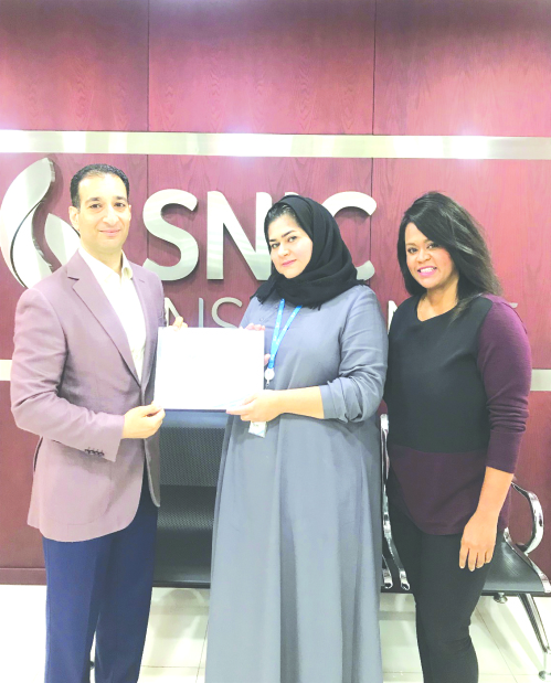<p>Bahrain-based SNIC Insurance presented customer service officer Zainab A Laith with the 'Going Beyond Award' for her excellent performance. She was honoured by general manager Khalid Al Shaikh and customer service manager Vicky Kilindo in the company's office in Salmabad. Above, Mr Al Shaikh, left, presents the award to Ms Al Laith, watched by Ms Kilindo.</p>