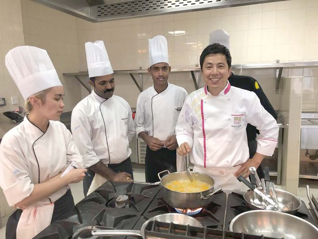 <p>Eleven Korean dishes will be exhibited this Friday at the Diplomat Radisson Blu Hotel, Residence and Spa. It is part of the 2018 Korean Cuisine Week hosted by the Korean Embassy and the hotel. Visitors to the hotel's Friday brunch at Al Fanar Restaurant are to expect a variety of Korean food such as Hobakjuk (pumpkin porridge), Oinaengguk (chilled cucumber soup), stir fried glass noodles and vegetables known as Japchae and other popular dishes. Two Korean master chefs, Jaesung Noh and Sunmyung Lee, were also invited from Korea to offer a four-day cooking class to the hotel's chefs along with local chefs. The Korean Embassy is also organising a Korean Agricultural Food Product expo in October in collaboration with Al Jazira Supermarket. Above, Chef Jaesung Noh, right, during the cooking class.</p>