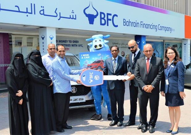 Javed Iqbal Khan was the lucky winner of an MG–ZS SUV as part of Bahrain Financing Company's 'Big Bonanza 2018'. The key to the car was handed over by BFC general manager Pancily Varkey during a ceremony held in front of the company's Manama branch. A total of 1,001 winners received cash prizes over the three-month campaign period. Above, Mr Varkey, fourth from right, handing over the keys to Mr Khan, fourth from left, in presence of BFC officials and Mr Khan's family members.