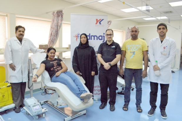 <p>More than 110 Y K Almoayyed and Sons (YKA) employees from its Nissan and associate divisions and their family members took part in a blood donation camp at Salmaniya Medical Complex. The event was part of the company's Edmaj (corporate social responsibility) programme. Above, an employee donates blood at the event.</p>