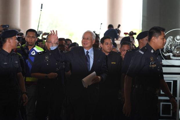 Malaysia ex-PM faces barrage of charges over $681m bank balance