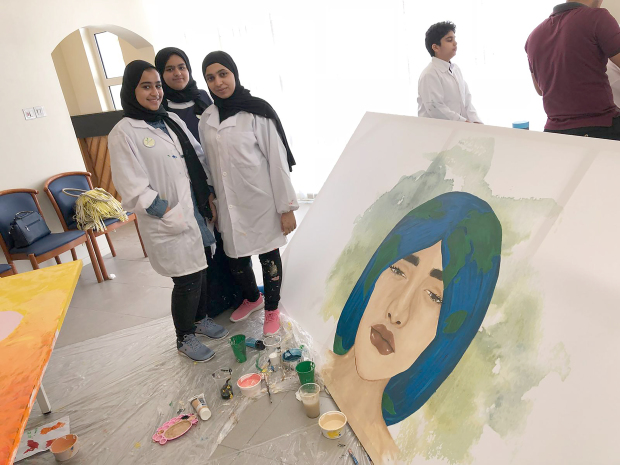 <p>Students from Khawla Secondary School for Girls took part in the Carbon Footprint Workshop for Secondary School Girls organised in co-operation with the Bahrain Authority for Culture and Antiquities. Above, students with their paintings at the workshop.</p>