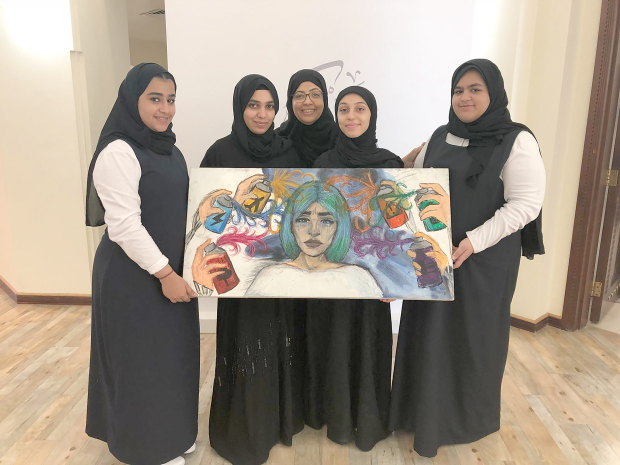 <p>Students with their paintings at the workshop.</p>
