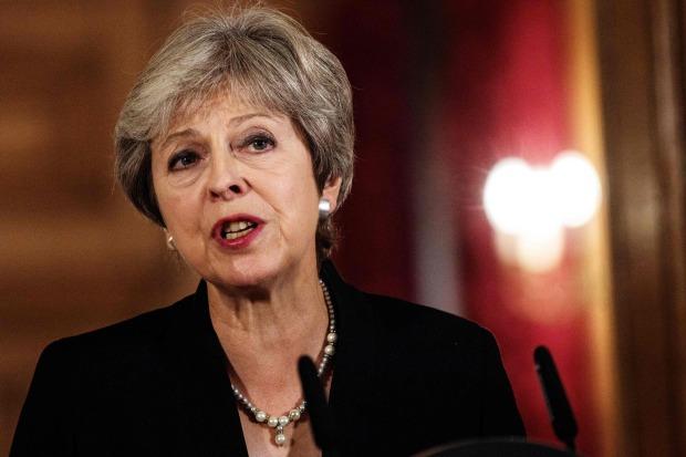 Defiant British PM hits back at EU over Brexit plan