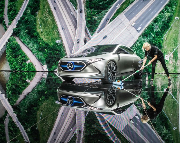 Late to the party, German carmakers join race against Tesla