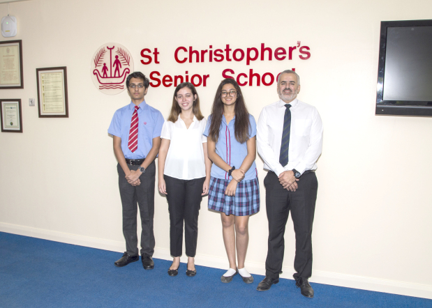 <p><em>Modern Foreign Languages department head Jamel Bazzouz, right, with Vansh, Giselle and Khushi</em></p> <p>Three senior school students of St Christopher's School were selected for the Summer 2018 French scholarship programme, hosted by the French Embassy in Bahrain.</p> <div>Vansh Patel and Khushi Kotilaine were awarded their scholarships having applied for them through the school, while Giselle Dias was awarded by the Alliance Française, in recognition of her outstanding performance in the DELF (Diplôme d'Etudes en Langue Française) exams last May.</div> <div></div> <div>The students represented the school, and Bahrain, in the French Riviera where they had the opportunity to fully immerse themselves in French culture and language, while allowing them to meet other students from across the world.</div> <p><em><br /></em></p>