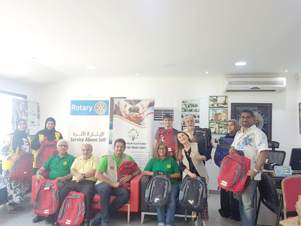 <p><em>Presenting school bags to Tree of Life Charity Society officials</em></p>