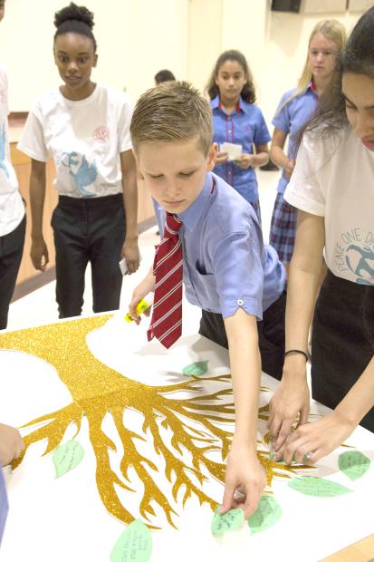 <p><em>Students making their Peace Trees</em></p>