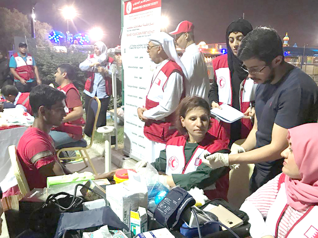 <p>A health awareness campaign was held by the Bahrain Red Crescent Society (BRCS) at Al Fateh Corniche. It featured lectures on healthy practices concerning food and workouts as well as other activities and programmes, including blood pressure and sugar tests. For children there was an entertainment corner which included games, gifts and face paintings. Present at the event was BRCS secretary general Dr Fawzi Amin. Above, a medical check-up camp.</p>