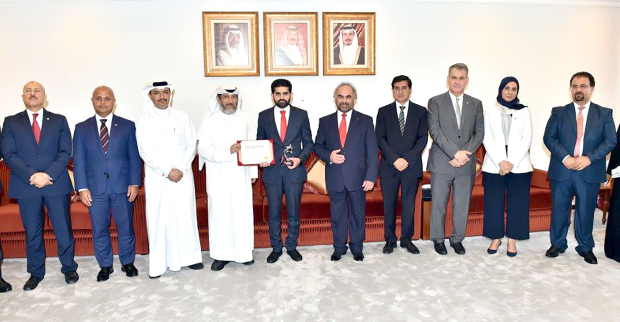 <p>An award was presented to Gulf Petrochemical Industries Company (GPIC) human resources department employee Yousef Al Kuwari for being the star employee for August. GPIC managing director Ibrahim Al Musaitir, in the presence of president Dr Abdulrahman Jawahery, and other officials, presented a certificate and the award to Mr Al Kuwari at the company headquarters in Sitra. Mr Al Kuwari joined the company in 2010 and is the library and data research assistant. Above, Mr Al Musaitir, fourth from left, presenting the award to Mr Al Kuwari, fifth from left, in the presence of Dr Jawahery, fifth from right, and other officials.</p>