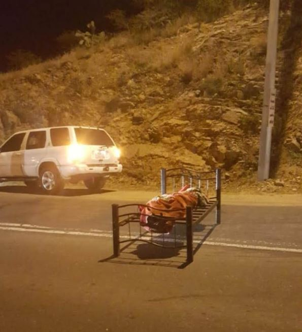 Body of expat found in the middle of the road had been shot