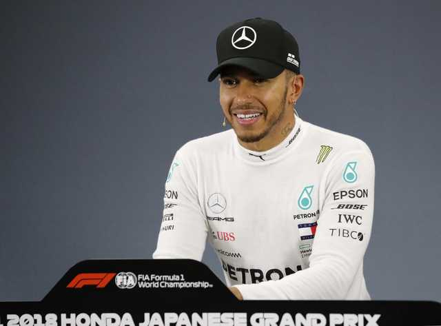 Hamilton storms to 80th pole in Japan, Vettel ninth