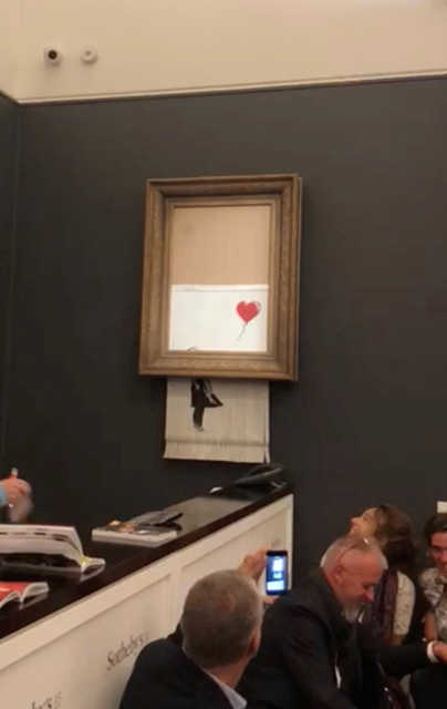 VIDEO: Banksy shocks art world by shredding £1 mn work at auction