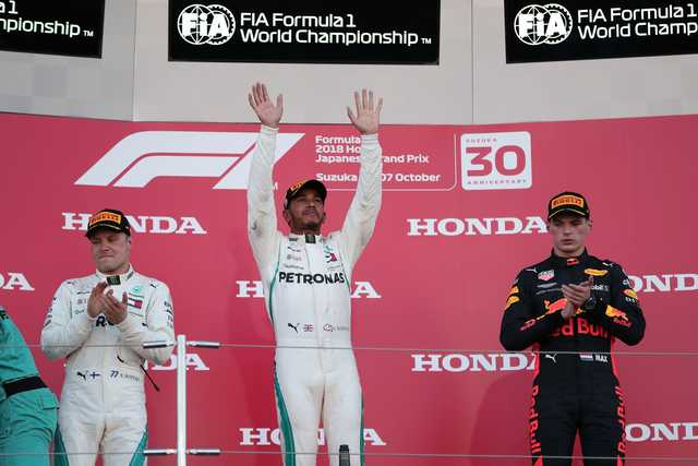 Hamilton wins in Japan, Vettel sixth