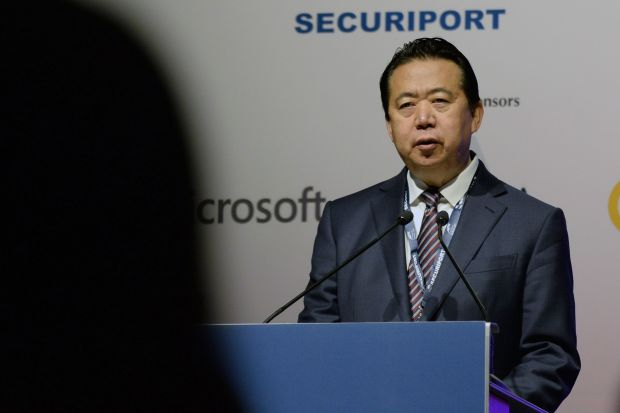 Ex-Interpol chief under probe for bribery, China ministry says