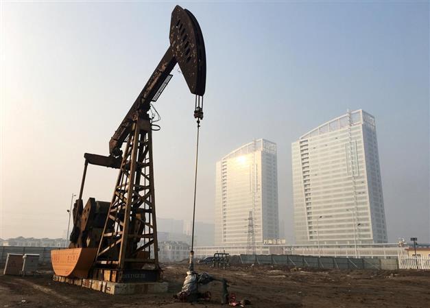 Oil dips as IMF lowers global growth outlook; eyes on U.S.