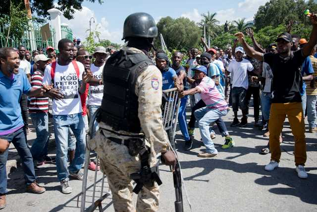 Thousands protest corruption in Haiti, president gets shoved