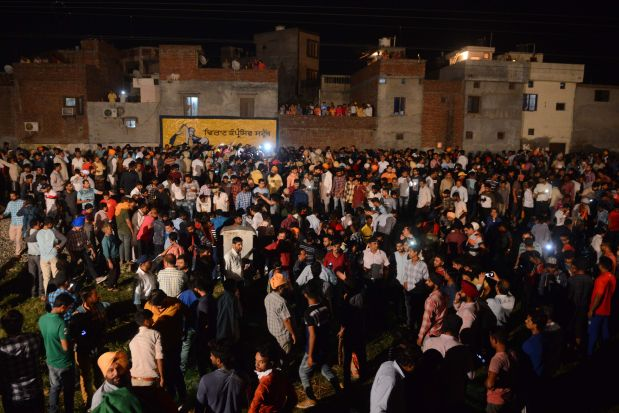India: At least 50 dead as train runs over crowd on railway track in Punjab