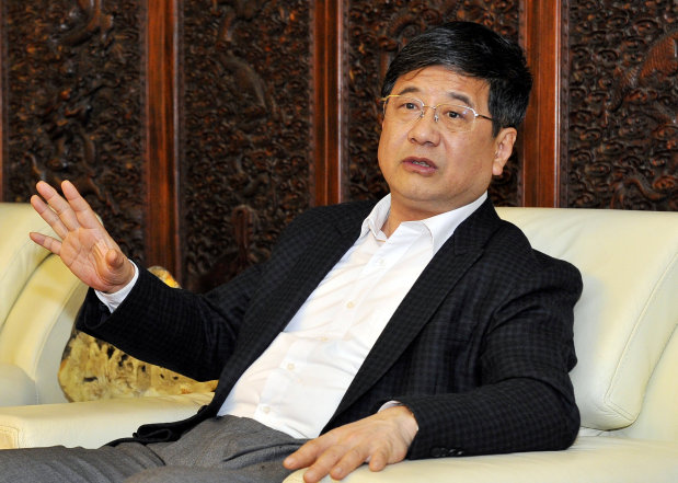 China's top Macau liaison official dead after fall from building