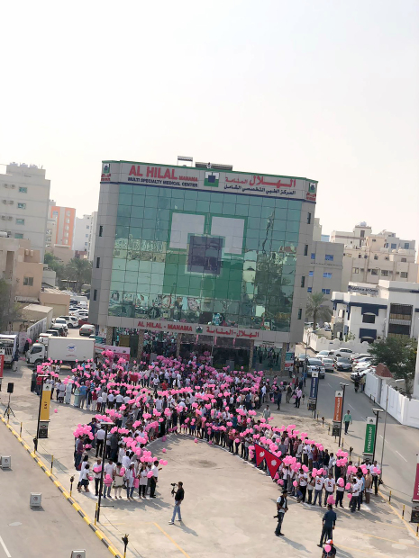 <p>A total of 2,138 people formed the largest human pink ribbon at Al Hilal Hospital parking in Adliya. The 100-metre by 50-metre giant ribbon was created in show of Breast Cancer Awareness month. The initiative was undertaken by Al Hilal Hospital and Medical Centre in co-operation with the Bahrain Public Transport Corporation and the Cancer Care Group (CCG). Participants had pink balloons and pink caps while wearing white T-shirts. Al Hilal is planning to get certified with a national record, while seeking a possible Guinness World Records entry. Participants were also offered free check-ups, including blood pressure, sugar, cholesterol, and kidney and liver screening. Above, participants form a pink ribbon.</p>