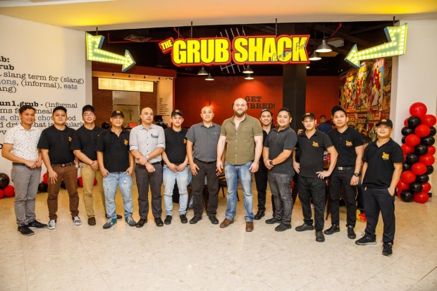 <div><i>Mr Nakfour, eighth from left, along with restaurant staff during the launch.</i></div>