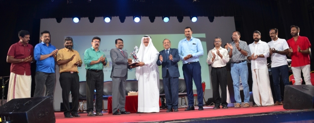 <div><em>Mr Pillai, fifth from left, honours Mr Bukamal, sixth from left, with other officials at the event.</em></div>