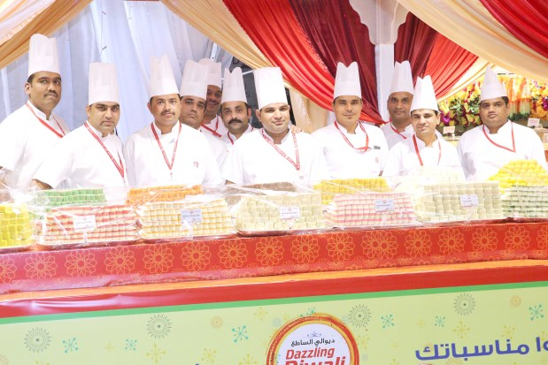 <p>Celebrations to mark Diwali, the Indian festival of lights, opened at LuLu Hypermarket in Dana Mall. A special area featuring more than 36 varieties of traditional Indian sweets and more than 20 types of snacks has been set up for shoppers. Diwali will be celebrated on November 7. Above, LuLu sweet makers at the largest Diwali counter in Bahrain.</p>