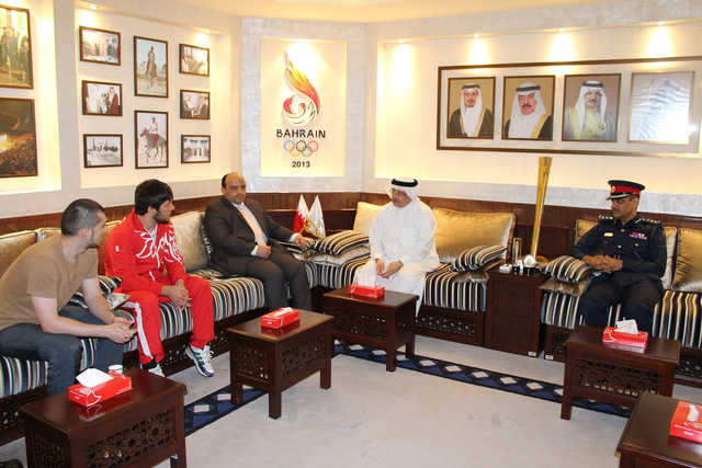 <p>Supreme Council for Youth and Sports assistant secretary general and Bahrain Olympic Committee (BOC) secretary general Abdulrahman Askar commended Bahraini wrestler Adam Batirov's performance at the recently-concluded World Wrestling Championships in Budapest. During a meeting with Batirov and his coach Eldar Eldarov, in the presence of Bahrain Mixed Martial Arts Federation president Khalid Al Khayyat and BOC board member Ali Esaaqi, Askar congratulated Batirov for winning 70kg freestyle silver medal at the event. Above, Askar at his meeting with Batirov and coach Eldarov.</p>