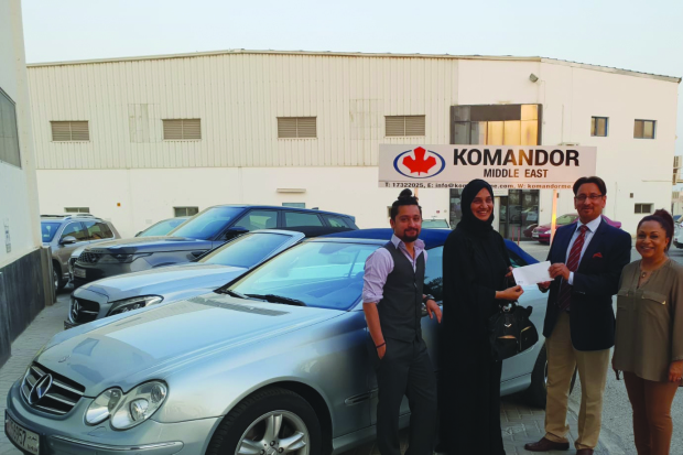 Komandor Middle East (KME) presented showroom manager Jameela Al Nooh with a Mercedes Benz CLK car in appreciation of 25 years of service and meeting the sales target for five consecutive years. Above, Ms Al Nooh, second from left, receives the car from KME chairman Raj Damani in the presence of managing director Yajur Damani, left, and vice-chairman Shubha Damani.