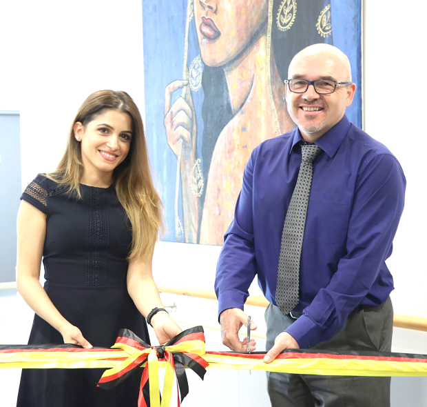 <p><em>Ms Al Ayoobi, left, at the launch of her exhibition with hospital chief executive Dr Heiner Abel</em></p>