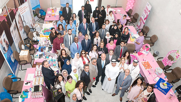 <p><em>Employees and management who took part in the day-long activities</em></p> <p>Bahrain's national carrier marked Breast Cancer Awareness Month with an event at its Muharraq headquarters attended by management and staff of the airline, Bahrain Airport Company (BAC) and Gulf Aviation Academy.</p> <div>The event, featuring health-related activities and information kiosks, was attended by BAC chief executive Mohammed AlBinfalah, GAA CEO Dr Dhaffer Al Abbasi, Gulf Air CEO Krešimir Kucko along with employees who received a full consultation and examination.</div> <p><em><br /></em></p>